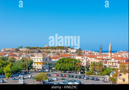 RETHYMNO, GREECE - OCTOBER 15, 2013: The view on the central part of the city with medieval citadel on the background, - Stock Photo