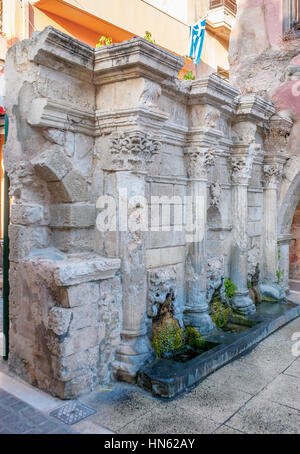 The well preserved medieval fountain located in the old town and still in use, Rethymno, Greece - Stock Photo