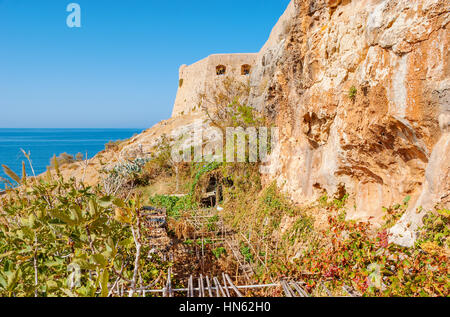 The garden of Ekklisia Agios Spiridon cave temple located on the sunny side of the Venetian fortress in Rethymno, - Stock Photo