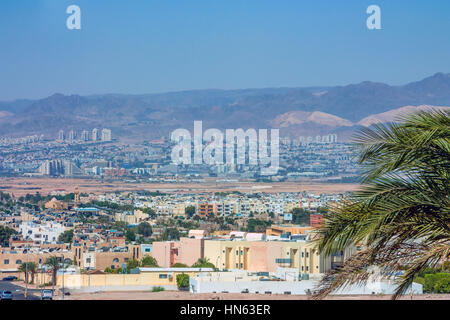 View from Jordan city Aqaba to neighbouring Eilat city in Israel - Stock Photo