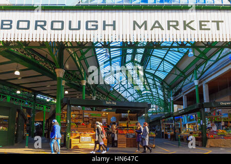 London, UK - November 7, 2016 - Tourists and food stalls at Borough Market - Stock Photo
