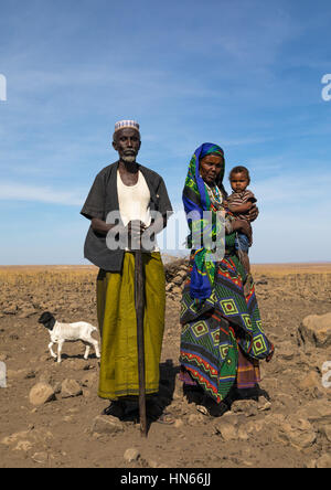 Issa tribe man with his wife and child, Afar region, Yangudi Rassa National Park, Ethiopia - Stock Photo