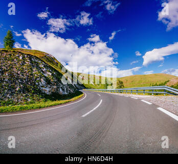 Winding Paved Road in the French Alps - Stock Photo