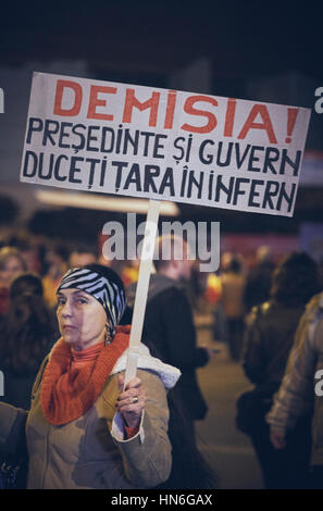 Bucharest, Romania - October 6, 2013: Adult woman holds a slogan placard during the mass riot against the cyanide - Stock Photo