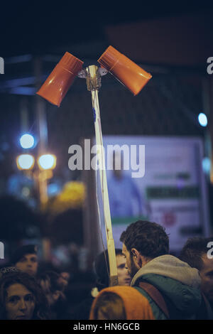 Bucharest, Romania - October 6, 2013: Young man chants slogans through megaphones during the uprising against cyanide - Stock Photo