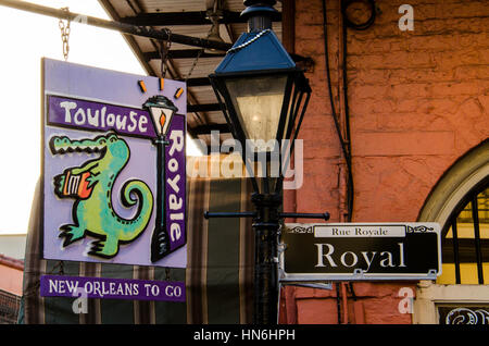 New Orleans, Louisiana - July 13, 2015: Royale street sign and Toulouse Royale To Go food business sign in French - Stock Photo