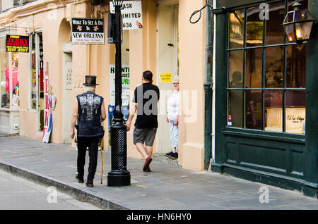 New Orleans, USA - July 13, 2015: Pedestrians walking on Royal Street of New Orleans, Louisiana near French Quarter. - Stock Photo