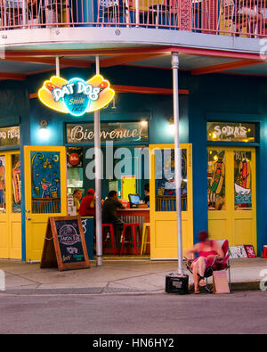 New Orleans, USA - July 13, 2015: Dat Dog restaurant on Frenchmen Street, French Quarter with people eating at the - Stock Photo