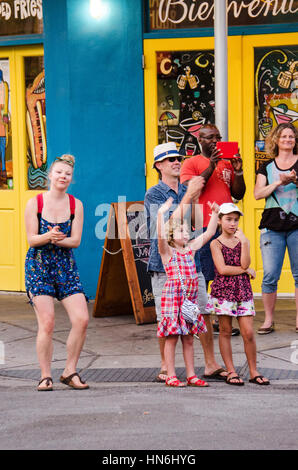 New Orleans, Louisiana - July 13, 2015: People cheer and dance at music played by local band in French Quarter, - Stock Photo