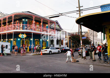 New Orleans, USA - July 13, 2015: People cheer and dance at music played by local band in French Quarter, New Orleans, - Stock Photo