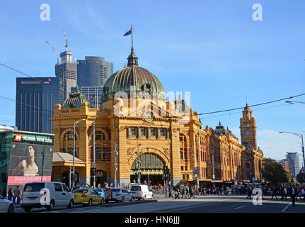Melbourne, Australia - May 14, 2014: Historic Flinders Street Rail Station building on the banks of the Yarra River - Stock Photo