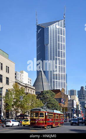 Melbourne, Australia - May 14, 2014: Vintage red tram in La Trobe street. In the background is the central tower - Stock Photo