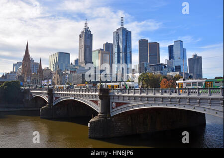 Melbourne, Australia - May 14, 2014: Melbourne city viewed from the South Bank of the Yarra River. In the foreground - Stock Photo