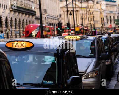 London Taxis Black Cabs queue for passengers in London's Piccadilly - Stock Photo