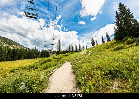 Ski Lift in Alpine Meadows in Albion Basin, Utah during summer - Stock Photo