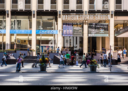 New York, USA - June 18, 2016: People walk near Madison Square Garden and Chase bank in New York City - Stock Photo