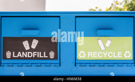 A blue trash container with two openings, landfill or recycle - Stock Photo