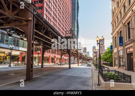 Chicago, USA - May 30, 2016: Downtown street with CTA train metro rail line - Stock Photo