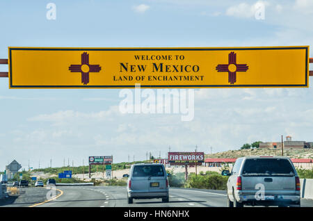 El Paso, USA - July 26, 2015: Welcome to New Mexico sign with land of enchantment words on highway at Texas border - Stock Photo