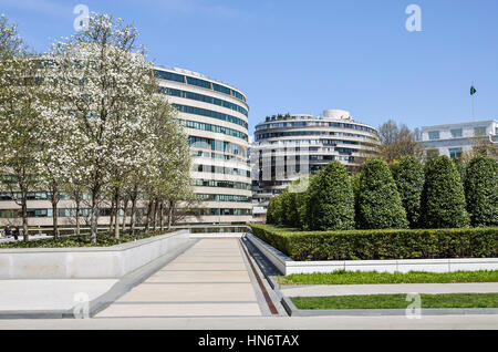 Washington DC, USA - April 12, 2015: Watergate residential building with cherry blossom flowers in spring and park - Stock Photo