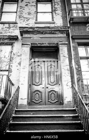 City Apartment Building Entrance.  Typical Entrance door to a New York City apartment building residential home Stock Photo