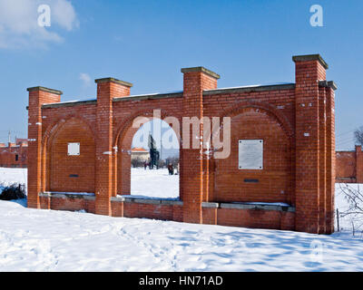 Wall Monument, one of the statues in a Snow covered Memento Park, Budapest.. - Stock Photo