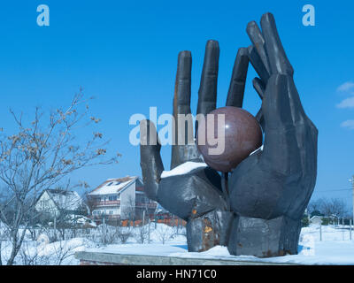 The Workers Movement Memorial, one of the statues in a Snow covered Memento Park, Budapest. - Stock Photo
