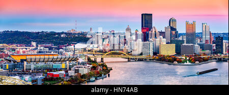 Pittsburgh, Pennsylvania skyline at sunset and the famous baseball stadium across Allegheny river - Stock Photo