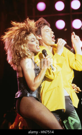 Mick Jagger and Tina Turner pictured performing in June of 1985. - Stock Photo
