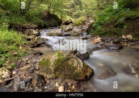 Mountain steam waterfall - Stock Photo
