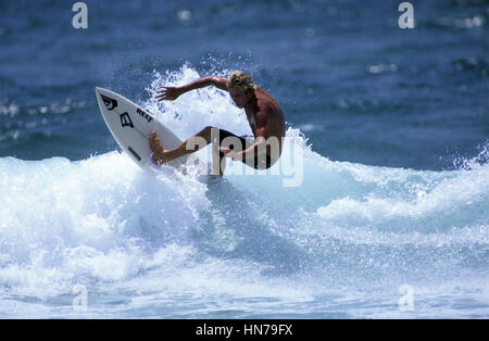 Surferturns off the top of the wave - Stock Photo