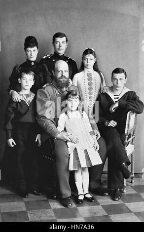 GRAND DUKE MICHAEL ALEXANDROVICH OF RUSSIA (1878-1918) as a child at left with his family. His father Alexander - Stock Photo