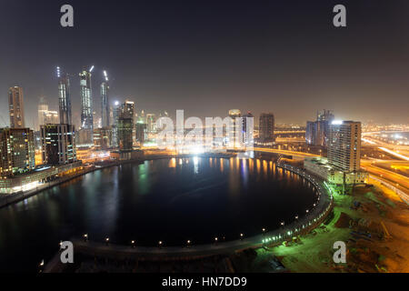 Construction site of the Dubai Business Bay illuminated at night. Dubai, United Arab Emirates, Middle East - Stock Photo