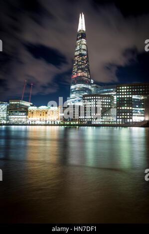 The Shard (Shard of Glass, Shard London Bridge), London Bridge Hospital and River Thames, London, at night. Stock Photo