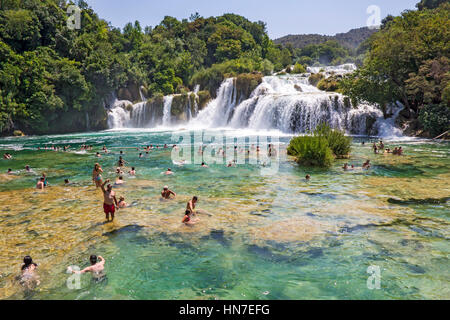 KRKA NATIONAL PARK, CROATIA - JULY 10, 2016: Many tourists  swim  in the Krka River in the Krka National Park in - Stock Photo