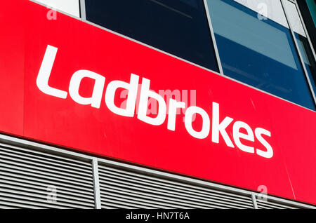 Sign above Ladbrokes betting shop - Stock Photo