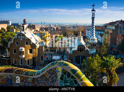 Spain, Catalonia, Barcelona, Park Guell houses with views over the city, by architect Antoni Gaudi - Stock Photo