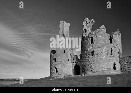 Summer skies, Dunstanburgh Castle, North Northumbrian Coast, Northumbria County, England, UK - Stock Photo