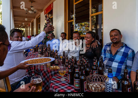 A Wedding Party, Guests At A Wedding Drinking Beer, Lake Ziway, Ziway, Ethiopia - Stock Photo