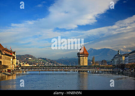 The famous Kapellbrücke ('Chapel Bridge'), a covered wooden footbridge across the Reuss River in the city of Lucern, - Stock Photo