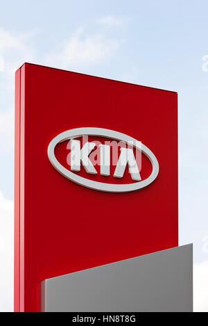 KIA logo at car dealer. KIA Motors, headquartered in Seoul, is South Korea's second largest automobile manufacturer. - Stock Photo