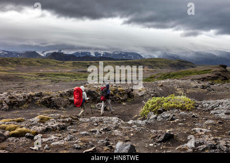 Hikers Heading South on the Laugavegur Hiking Trail (Laugavegurinn) Near Thorsmork with the Eyjafjallajokull Volcano - Stock Photo
