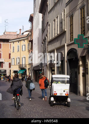Post office electric car circulating in the limited traffic city center, Parma, Italy - Stock Photo