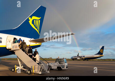 Boarding Ryanair aircraft with rainbow at Bristol Airport, England, UK - Stock Photo