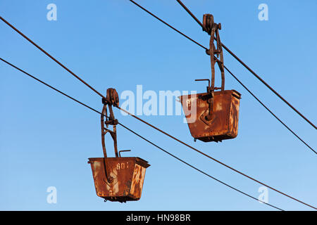 Buckets on the aerial tramway leading from the old coal mine at Longyearbyen, Svalbard, Norway - Stock Photo