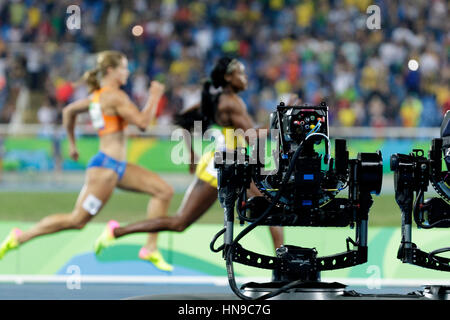 Rio de Janeiro, Brazil. 17 August 2016.  Athletics, TV cameras track the Women's 200m finals at the 2016 Olympic - Stock Photo