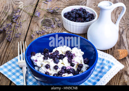 Healthy food: cottage cheese with frozen blueberries - Stock Photo