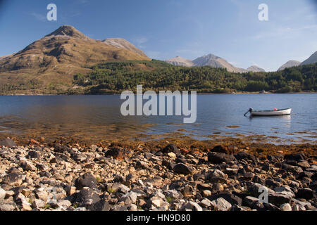 Little boat at loch Leven, Near Ballachulish, Glencoe, Scottish Highlands, Scotland, with the Pap of Glen coe at - Stock Photo