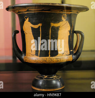 Red-figured krater on black ground. Decorated with two figures holding a staff. Exhibition Myth and Nature. From - Stock Photo