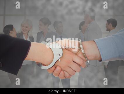 Digital composite of Handshake with handcuffs in front of business people with grunge overlay - Stock Photo